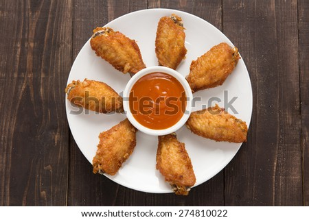 Top view fried chicken wings on wooden background. - stock photo