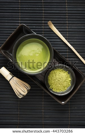 Top view green tea matcha set on the black mat, Japanese style - stock photo