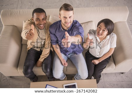 Top view. Group of business people showing thumbs up at office. - stock photo