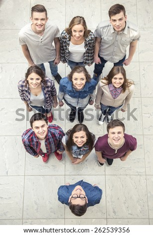 Top view. Happy smiling young group looking at camera. - stock photo