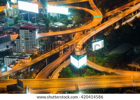 Top view highway interchanged, long exposure night view - stock photo