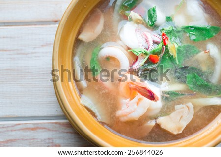 Top view, Hot and sour soup and seafood in condensed water, Thai traditional food.  - stock photo