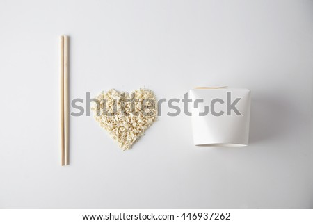 Top view I love wok takeaway noodles presentation with chopsticks, blank box and dry pasta isolated on white - stock photo