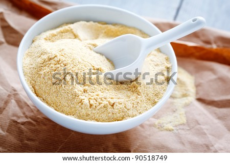 Top view image of a bowl with chickpea flour. - stock photo
