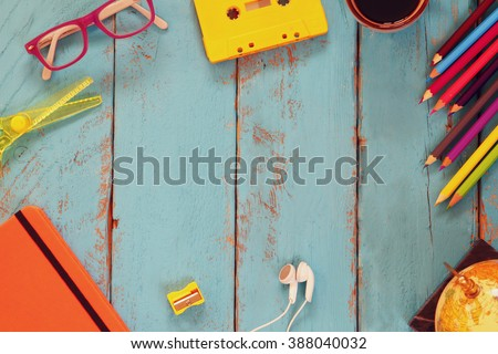 top view image of school supplies on wooden table. vintage filtered. education concept - stock photo