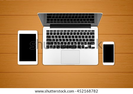 Top view laptop computer with mobile phone and tablet on office dask.Business template mock up for adding your text