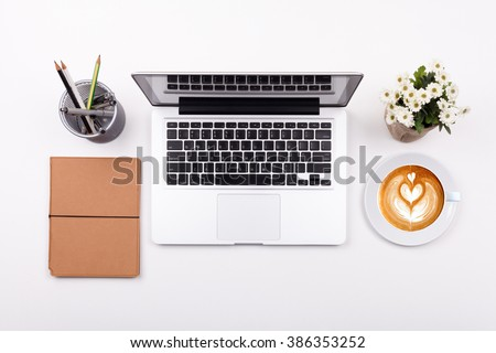 Top view laptop or notebook workspace office and latte coffee on white table - stock photo