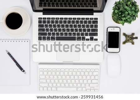 Top view laptop or notebook workspace office on white table