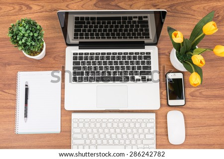 Top view laptop or notebook workspace office on wooden table - stock photo