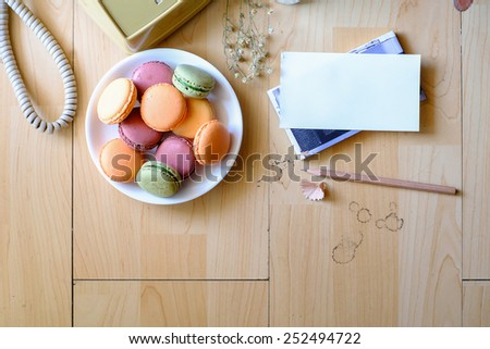 Top view Macarons on wood  - stock photo