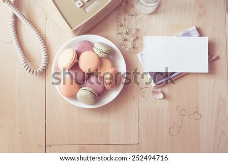 Top view Macarons on wood ,vintage macaron - stock photo