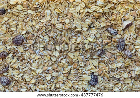Top view, oat, bran and macadamia corn flake breakfast cereal, bran cereal with raisins, natural granola with fruits and nuts. - stock photo