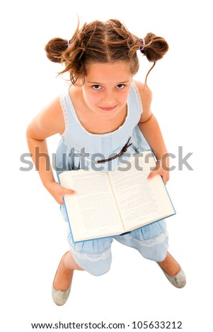Top view of a adorable little girl reading a book, isolated on white - stock photo