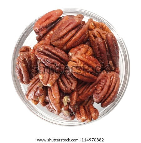 top-view of a bowl filled of raw pecans - stock photo
