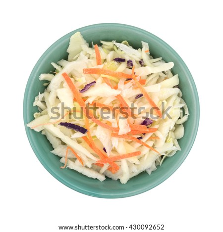 Top view of a bowl filled with coleslaw isolated on a white background.