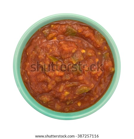 Top view of a bowl of chunky spicy salsa sauce isolated on a white background.