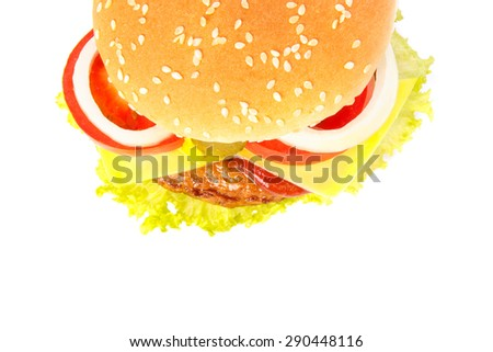 Top view of a burger with cheese, pickles, onion, tomato, ketchup and mustard on white background - stock photo