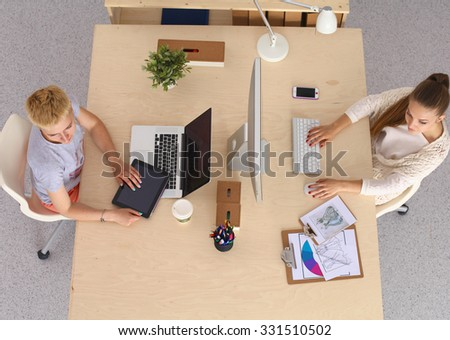Top view of a business team sitting at a table for discussion. - stock photo
