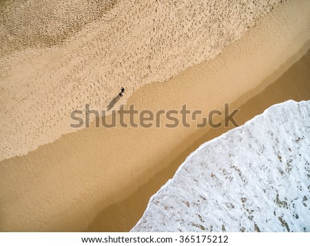 Top View of a Couple in a Beach - stock photo