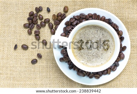 Top view of a cup of coffee with foam art 2015 pattern  - stock photo