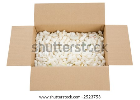 top view of a filled cardboard box isolated on white background - stock photo