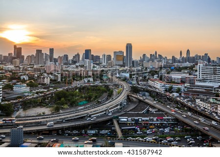 Top view of a freeway traffic jam on sunset  .Panoramic and perspective wide angle  high rise building skyscraper commercial  city of future. Business concept of success industry tech architecture - stock photo