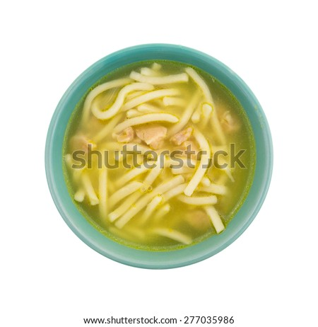 Top view of a green small bowl with a serving of chicken noodle soup isolated on a white background. - stock photo