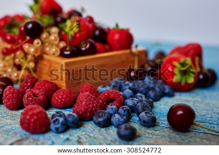 Top view of a light breakfast for the entire family of ripe juicy berries from the garden, fresh and healthy - stock photo
