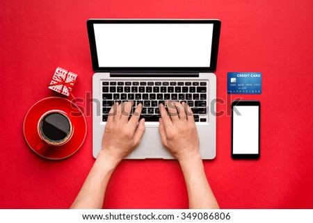 Top view of a Man buying christmas gifts online - online shopping concept. View from above with copy space - stock photo