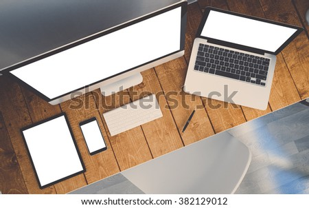 top view of a mock-up with computer, laptop, smartphone and tablet on a desktop workspace. 3d Illustration. - stock photo