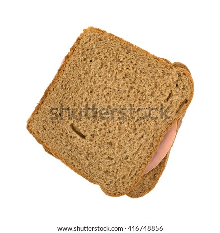Top view of a mortadella sandwich on whole wheat bread isolated on a white background.