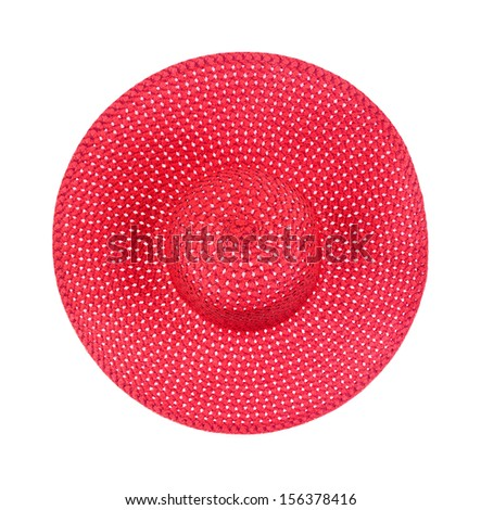 Top view of a new large brimmed red straw ladies hat on a white background. - stock photo
