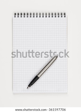 Top view of a notepad. Single object isolated on white background. Concept photograph with copy space. Writing or noting accessories theme. - stock photo