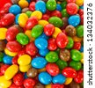 Top view of a pile of colorful chocolate candies - stock photo