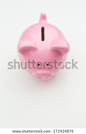 Top view of a pink piggy bank over a white background. - stock photo