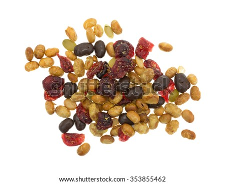 Top view of a portion of trail mix with soy beans, dried cranberries and pumpkin seeds sprinkled with sea salt isolated on a white background. - stock photo
