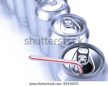 Top view of a row of soda cans. - stock photo