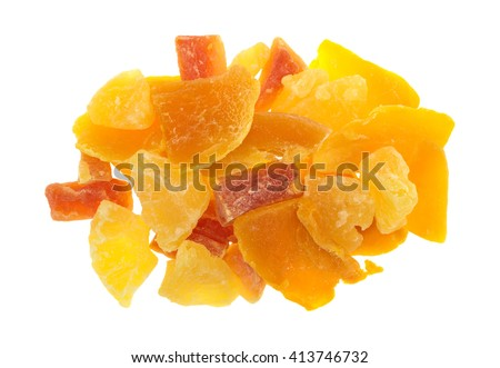 Top view of a serving of pineapple, mango and papaya sugared dried fruit isolated on a white background. - stock photo