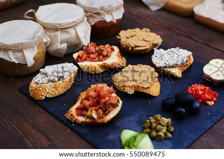 Top view set appetizer canapes baguette stock photo for Canape toppings
