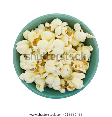Top view of a small bowl filled with a serving of white cheddar cheese flavored popcorn isolated on a white background. - stock photo