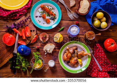 Top view of a Table setting with a variety of side dishes on a wooden table - stock photo