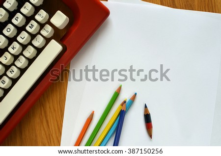 Top View Of A Typewriter With Blank Sheets Of Paper - stock photo