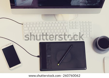 top view of a work space with organized tools - stock photo