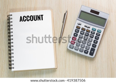 Top view of Account wording on notebook with calculator and pen concept - stock photo