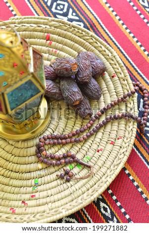 Top view of an arabic dates, lantern and prayer beads - Ramadan objects - stock photo