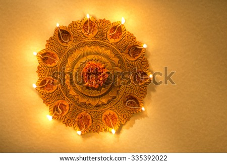 Top view of an illuminated terra-cotta Diwali lamp. View from above. - stock photo