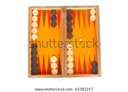 Top view of an old wooden Backgammon game board with buttons and dices. Image isolated on white studio background. - stock photo