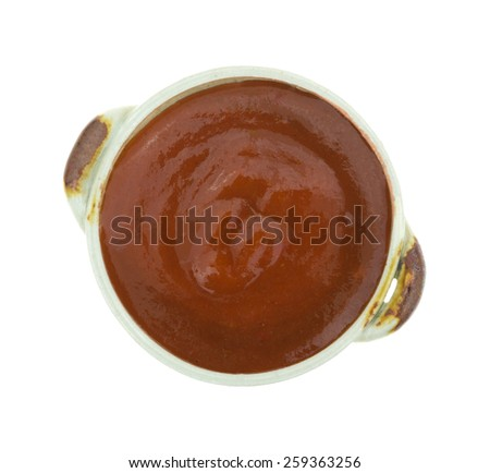 Top view of an small bowl of taco sauce on a white background. - stock photo