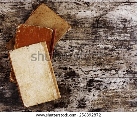 top view of ancient books on wooden table - stock photo