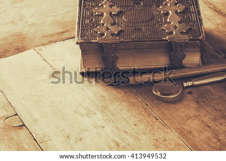 top view of antique book cover, with brass clasps. sepia vintage filtered and toned